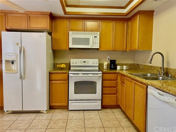 Kitchen with tile floor, stainless sink and all appliances included