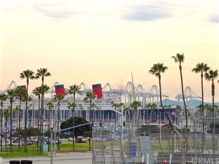 View of Queen Mary and Catalina in the background from the promenade by the building