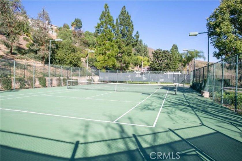 Association Tennis Court with basketball hoop