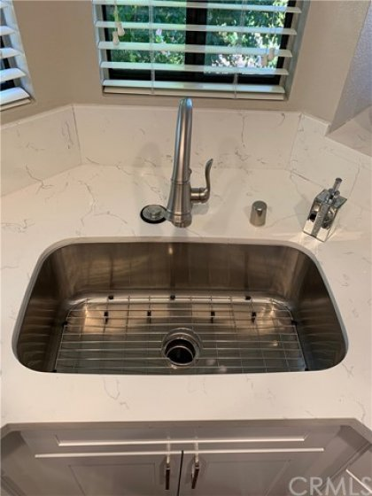 New deep sink basin, faucet and garbage disposal.