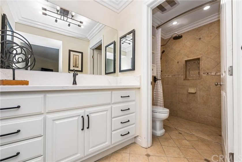 Spacious dressing area and wheelchair accessible bath.  Wheel directly into this custom built shower/wet room.   The shower features multiple shower heads.