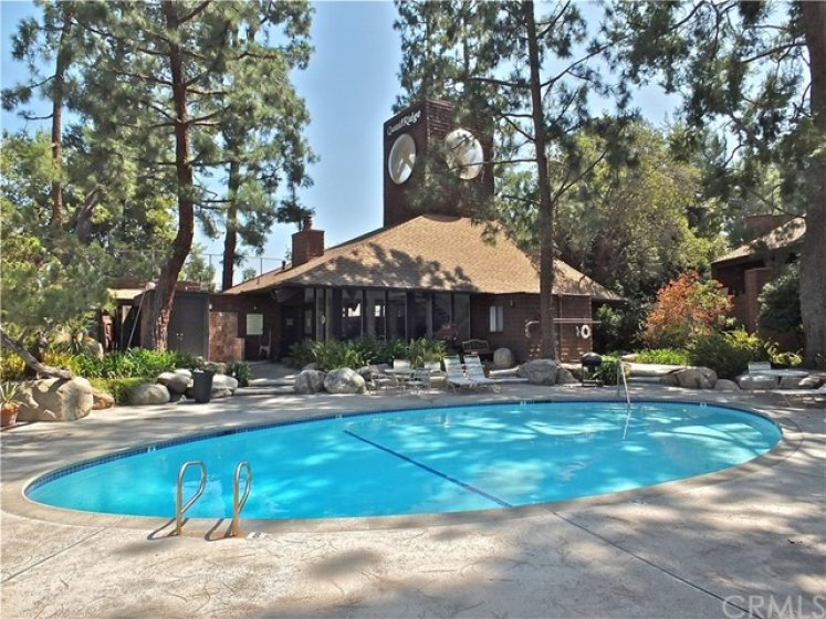 Beautiful community pool with large clubhouse