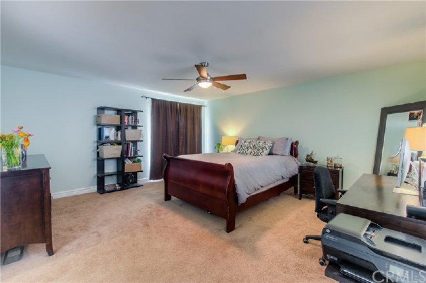 Large master suite with walk-in closet and balcony
