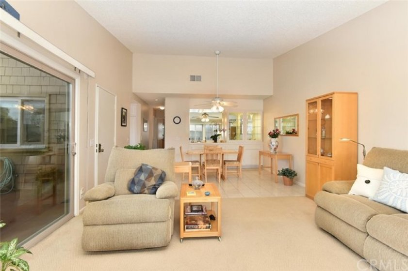 Living room and dining room are open to each other offering a spacious area for entertaining.
