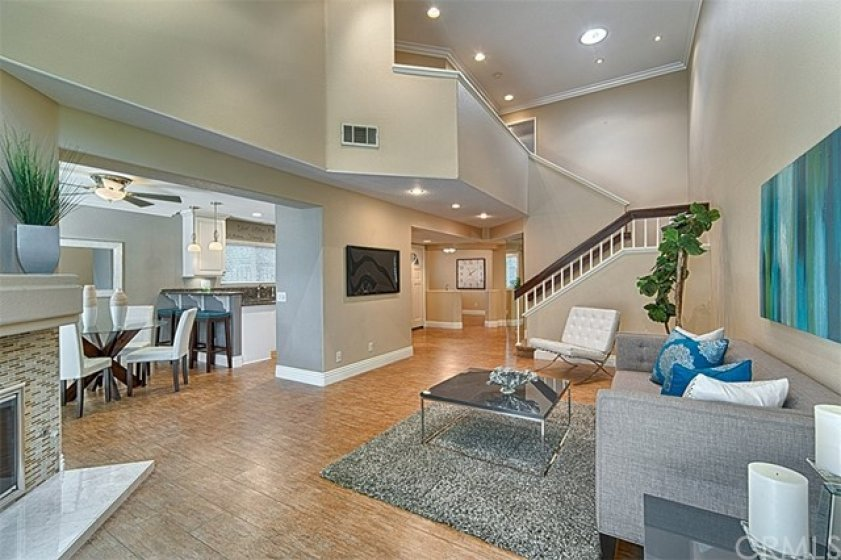 Open floor plan with lots of light and wood tile flooring.