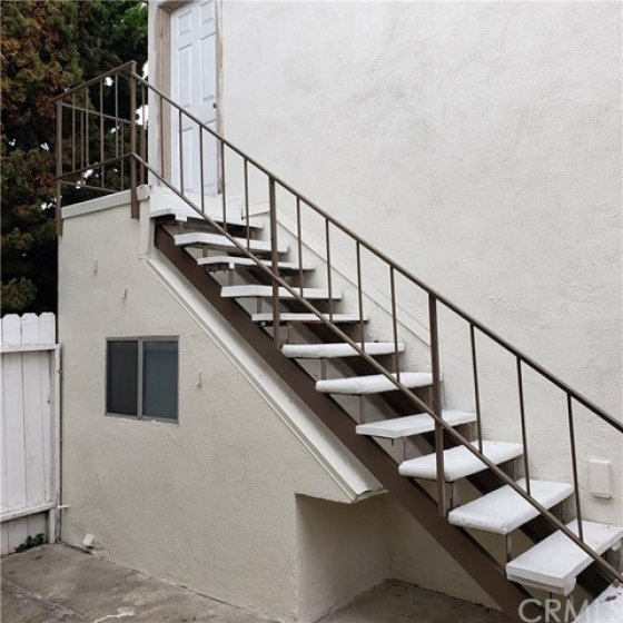 Stairs to room/bathroom over garages.