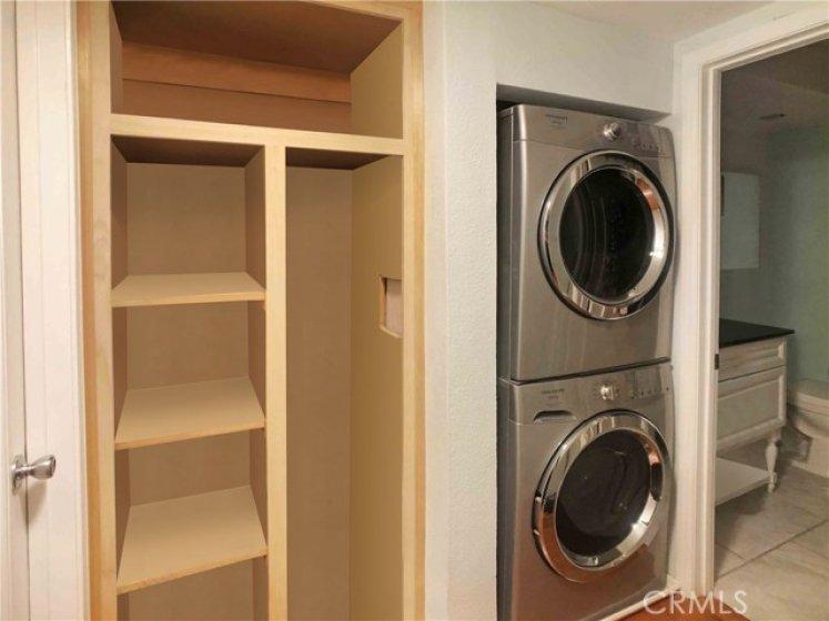 Hall closet, washer dryer and bathroom