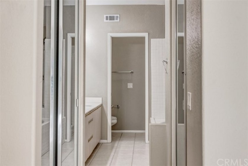 Ensuite master bathroom, which has two sliding mirrored closets with brand new carpet inside of the closets.