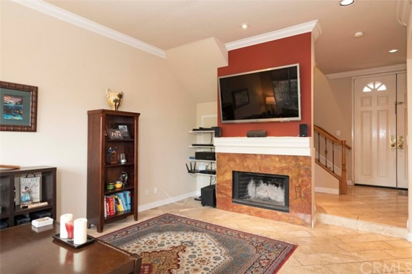 Living Room View 2 - note upgraded tile floors and gas fireplace