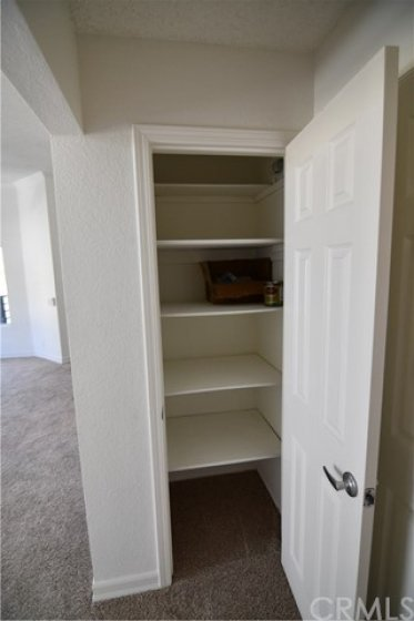 Good size linen closet in the hallway. Note the 6 panel door and the new door knob. New carpet all painted and ready to move in.