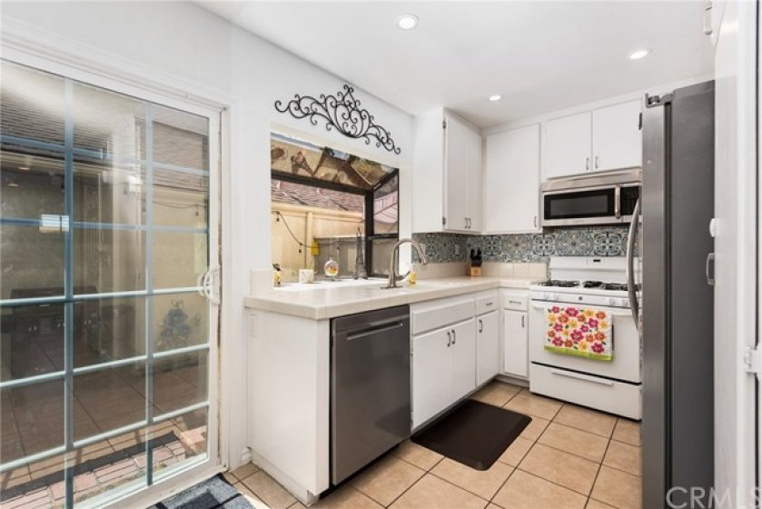 Light bright kitchen looks out to your private patio.
