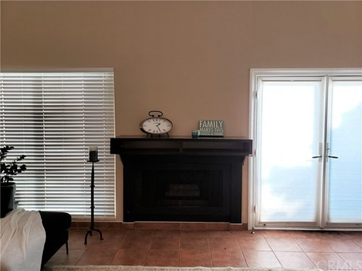 Gas fire place.  Large double pane windows. double glass doors with sun shade that leads cozy patio.