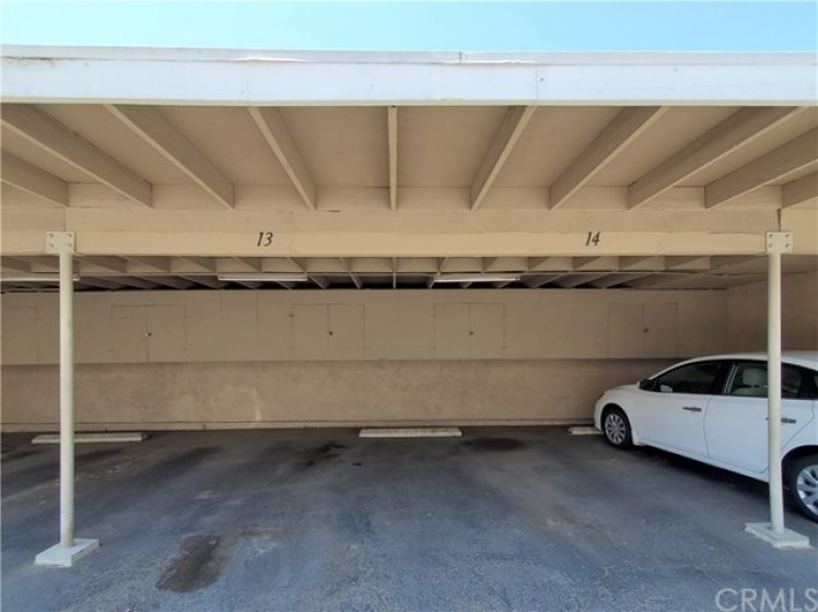Two Side-By-Side Carport Parking Spots Close to