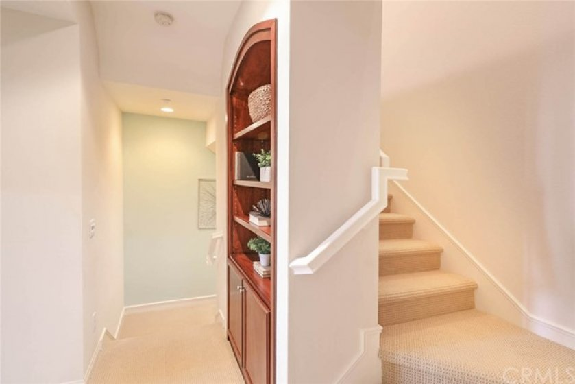 Custom built ins offer additional storage and displace space.