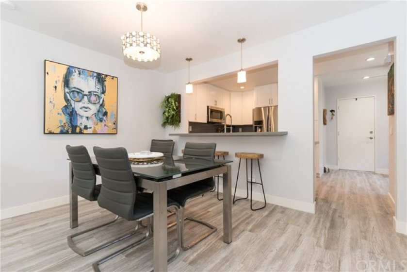 Wonderful dining area with enlarged opening to the kitchen.