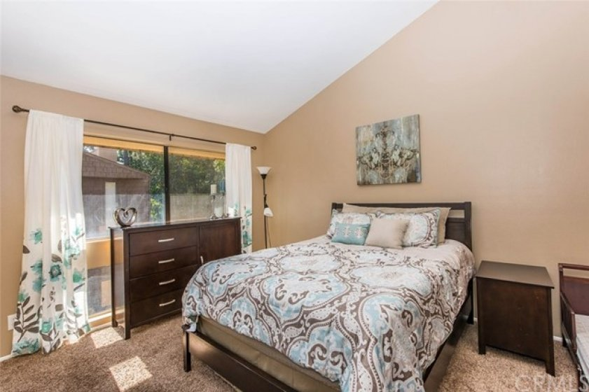 Master Bedroom - vaulted ceiling, large windows, carpet flooring - its spacious and plenty quiet for sure!