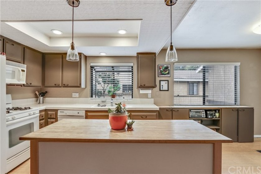 A center island adds functionality to the kitchen.