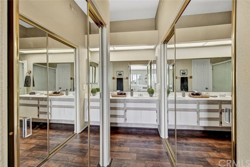Two closets each with mirrored doors
