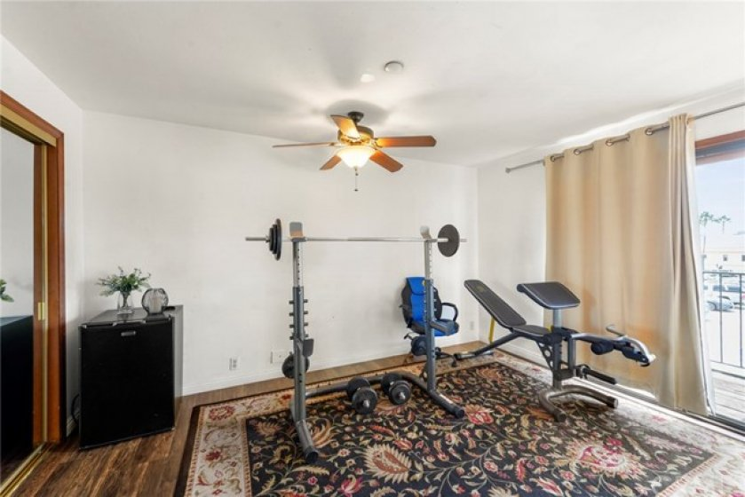Master bedroom currently used as a gym.