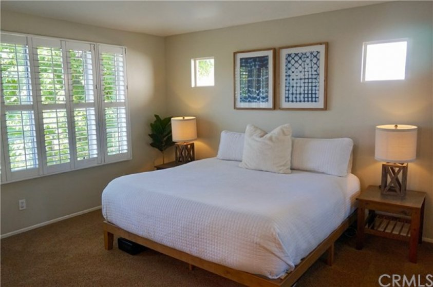 Sumptuous, elegant master bedroom with a peaceful tree top view.  Nighty-night!