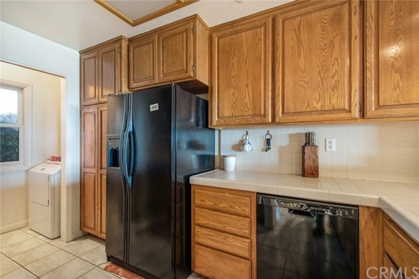 Kitchen with pantry cabinet w/laundry room conveniently located