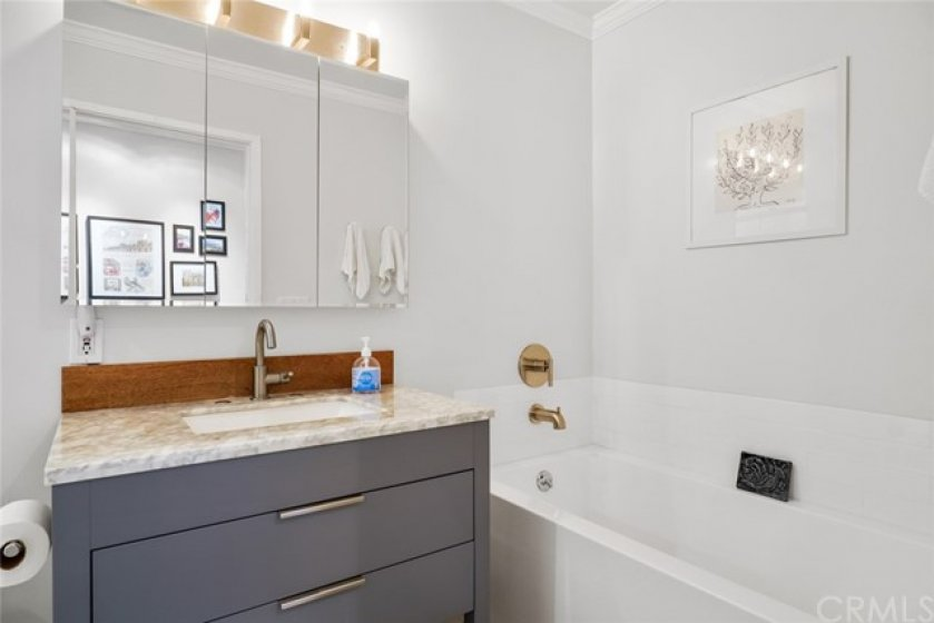 There are not enough words to describe this very recently updated bathroom.  Separate tub and shower.  Beautiful.