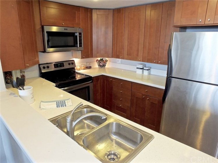 New Quartz Counters, Stainless Steel Appliances, And Rich Wood Cabinets In Your New Kitchen.