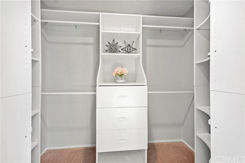 Beautiful built-in in the master closet are a dream!