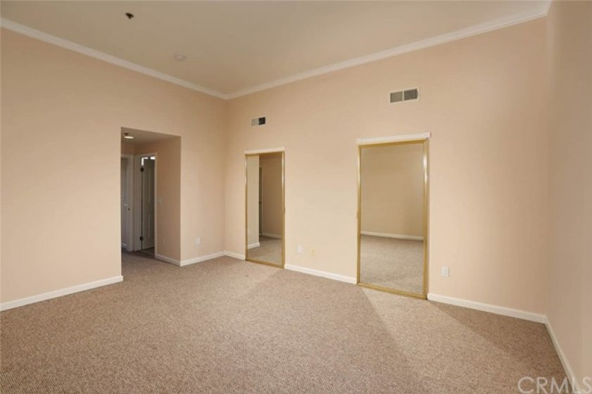 Master suit with 11 ft high ceilings and walk-in closets