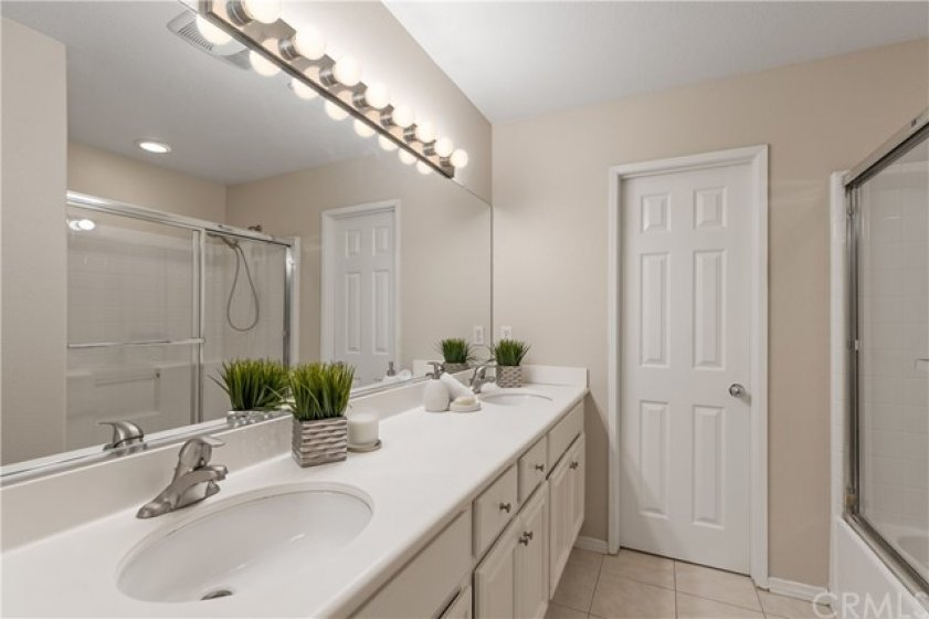 Master Bathroom with double sink and shower in the tub