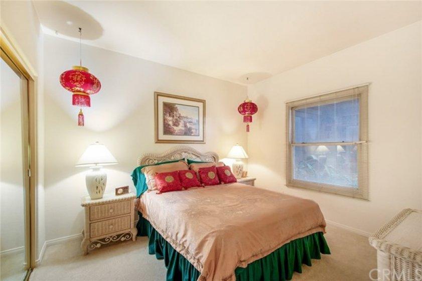 Second Bedroom with Mirrored Closet Doors