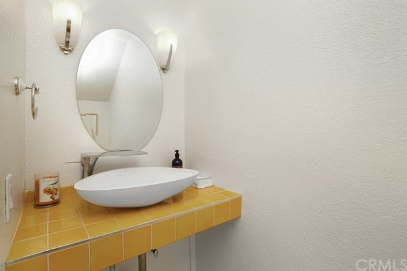 Cheerful main floor powder bath with Toto Toilet.