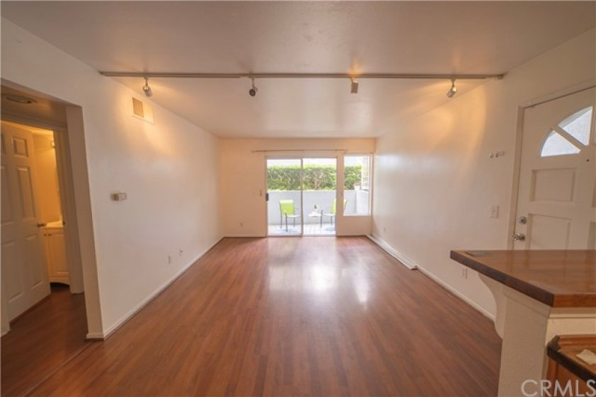 Spacious living room with beautiful hardwood floor and private patio access!