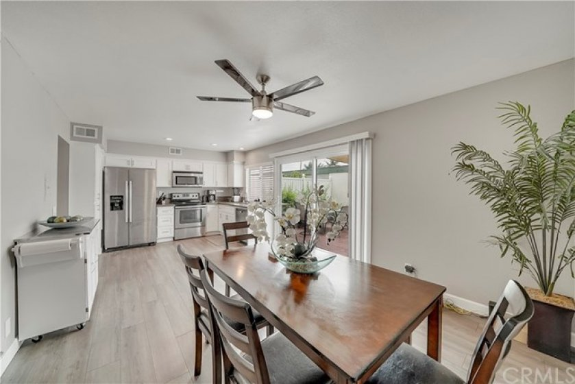 Remodeled kitchen and dining area. Updated cabinetry, pantry, stainless steel appliances. quartz counters and modern ceiling fan. Opens to enormous patio/yard, which connects to your private 2-car garage.