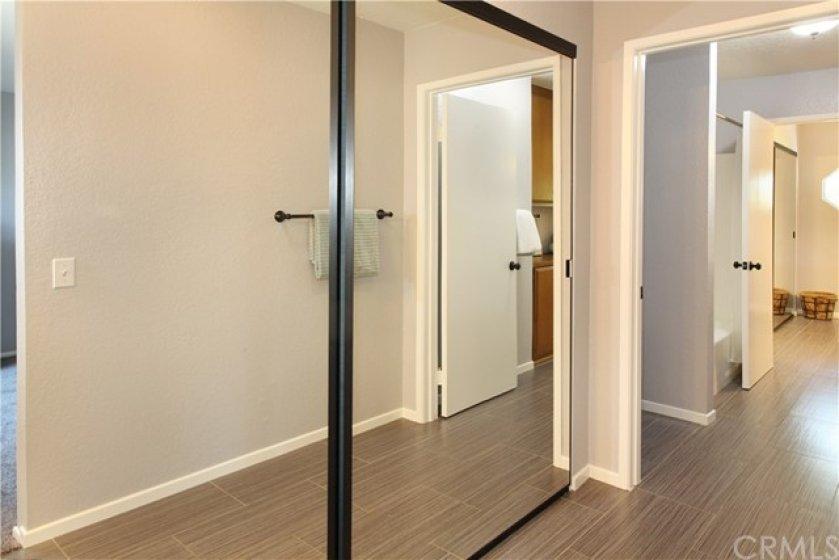Mirrored closet doors are in vanity area of both bedrooms