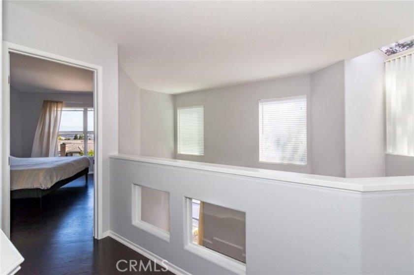 Second floor walkway leads to master bedroom