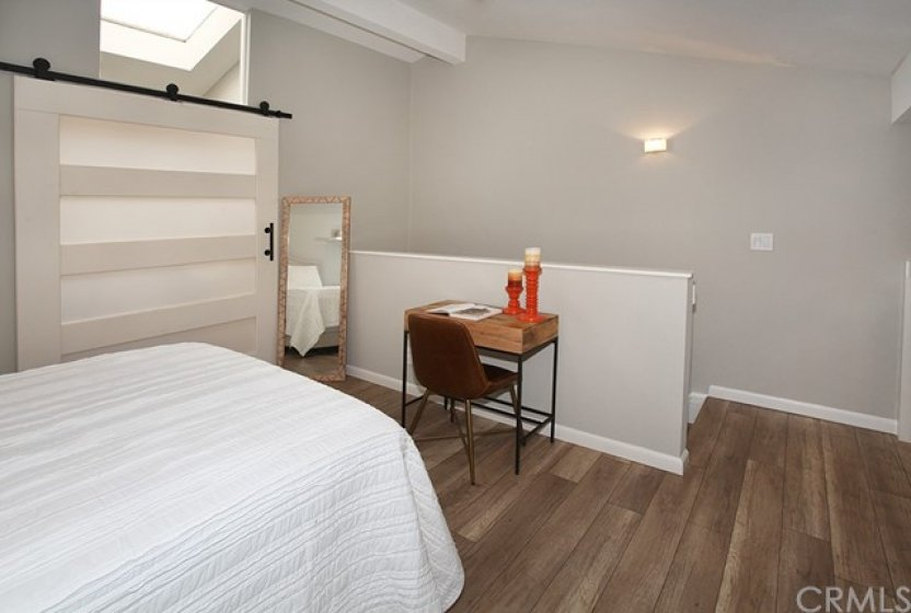 Laminate flooring, baseboard trim, beamed ceilings, it's all done for you. Move right in.