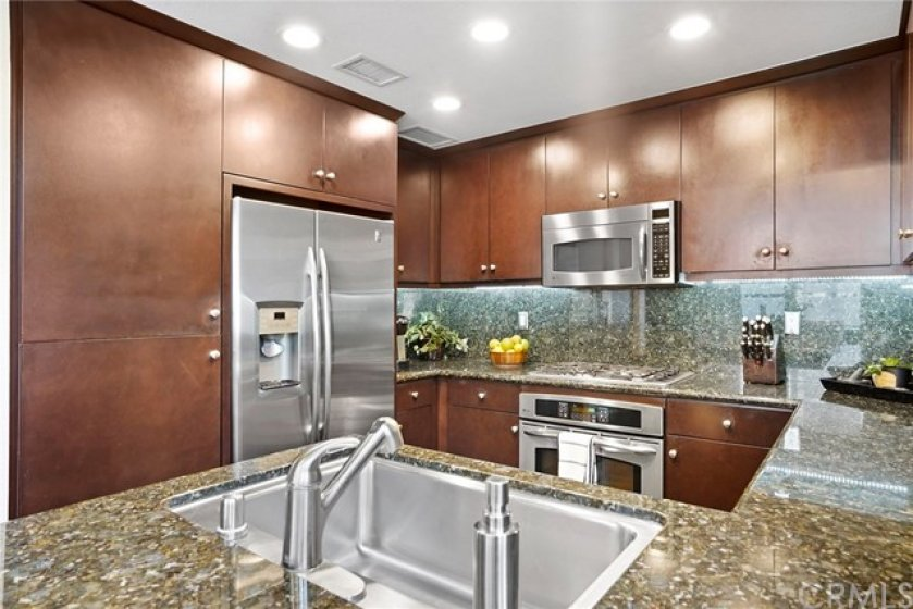Gourmet kitchen is fully equipped w/stainless steel appliances