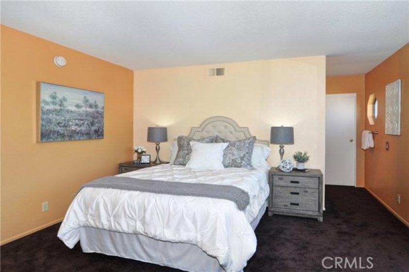 Relaxing master bedroom with upgraded ensuite bath and wide double door closet