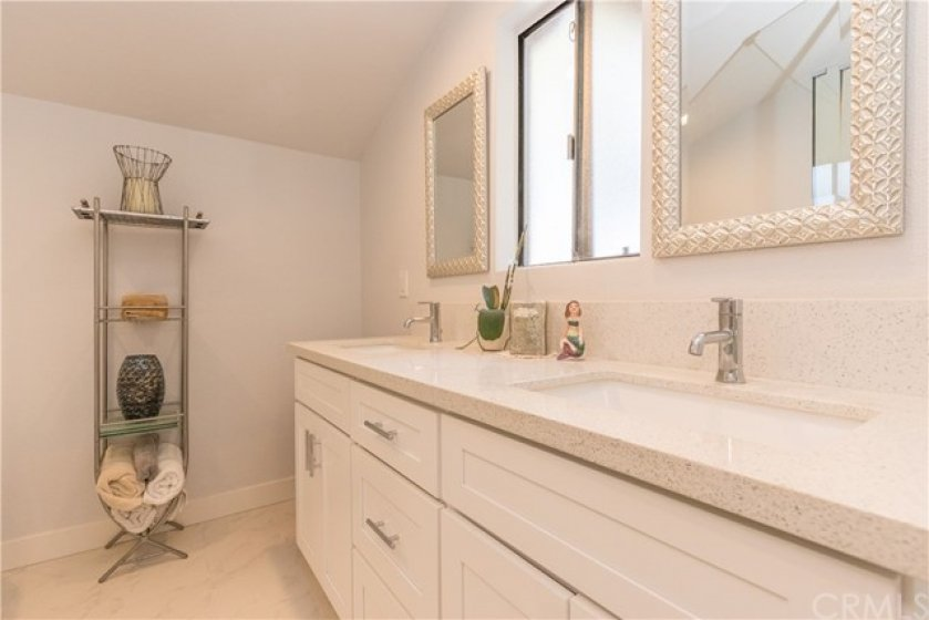 Quartz counters, white cabinets.