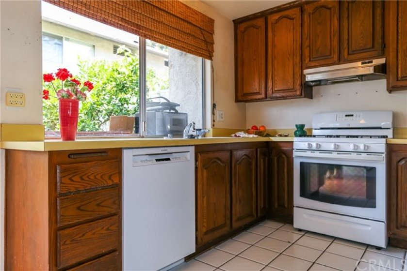 Kitchen has newer appliances and view of the back yard.