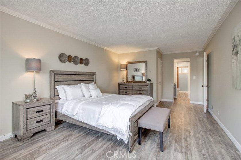 Luxury suite with walk in closet, separate vanities, full shower & bath plus a sauna.