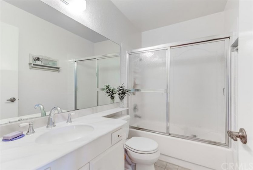 Bathroom #2 is bright and clean.