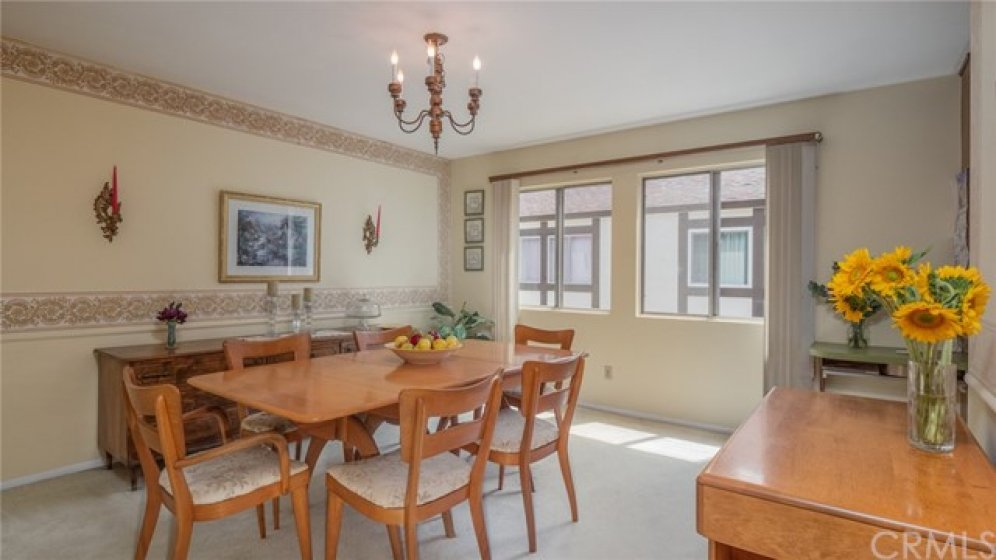 The bright formal dining room connects the kitchen with the living room.