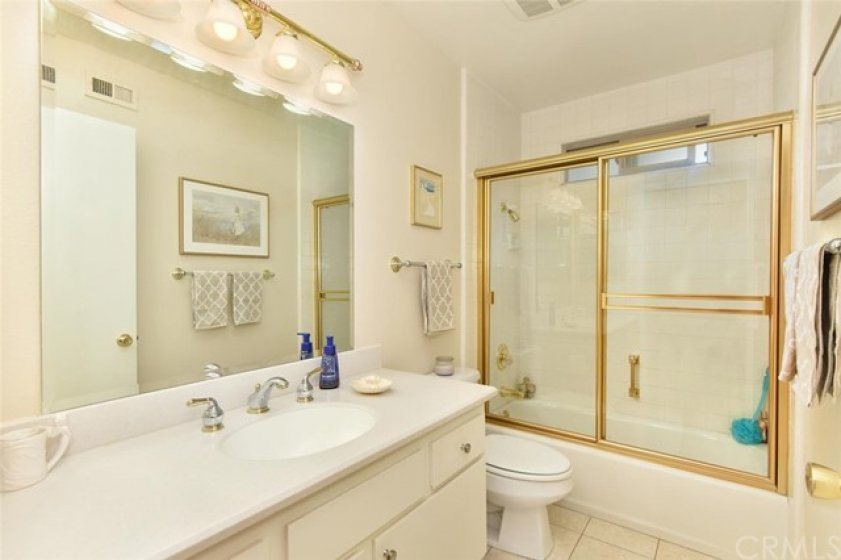 Full bath with corian counters & high-end faucets.
