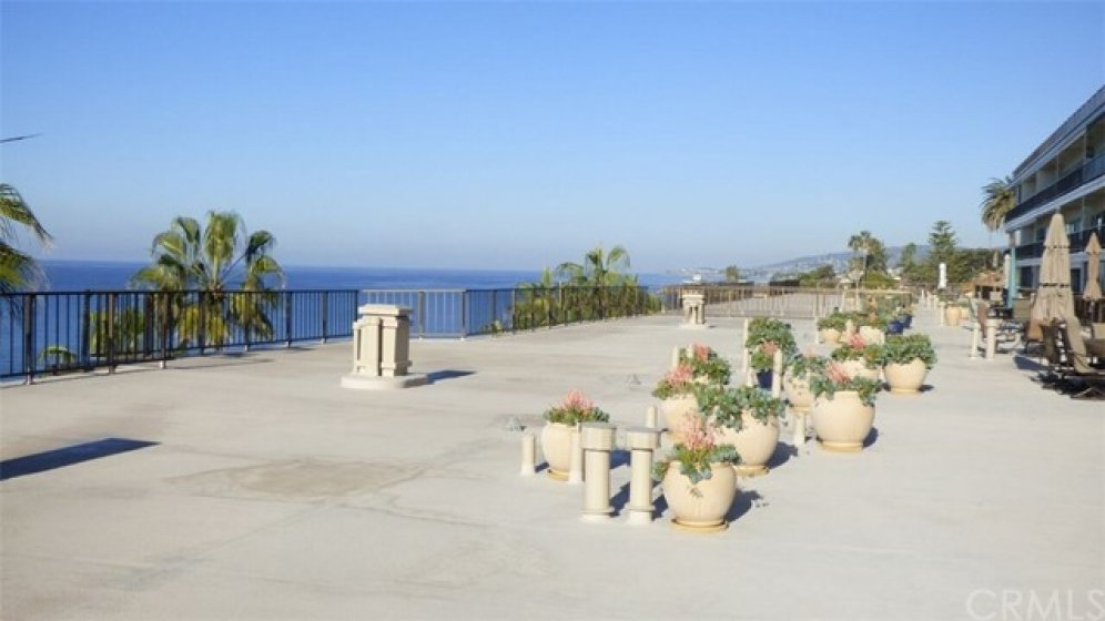 Community deck facing North Laguna coastline views and Catalina sunsets.