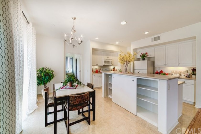 Full Size Dining Area and Center Island with Breakfast Bar and Storage Shelving