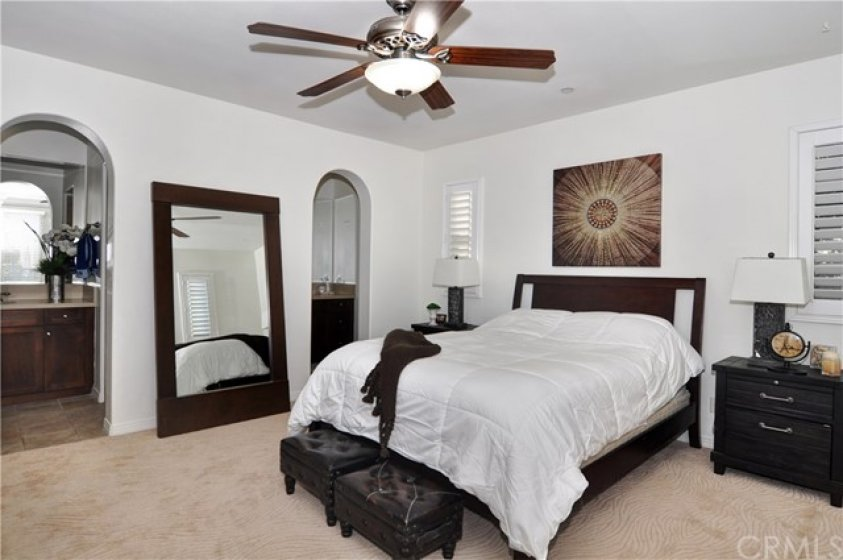 Master Suite with Plantation Shutters and Ceiling Fan