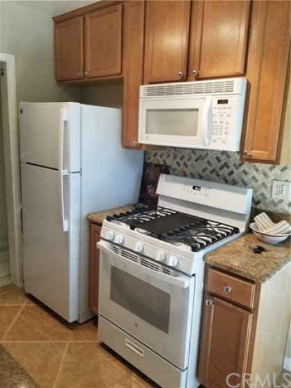 4 piece appliance suite conveys with unit.  Gas range w/broiler has NEVER been used!  Refrigerator has NEVER been used.  Overhead microwave, and dishwasher.