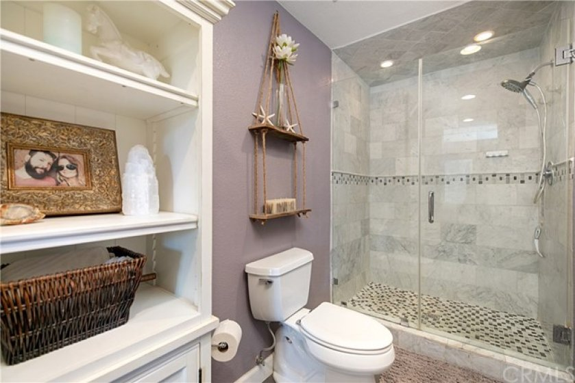 Remodeled master en-suite boost custom flooring, Restoration Hardware dual master sink piece, marble tiled shower with glass door. Very spacious and open for a spa-like ambiance.